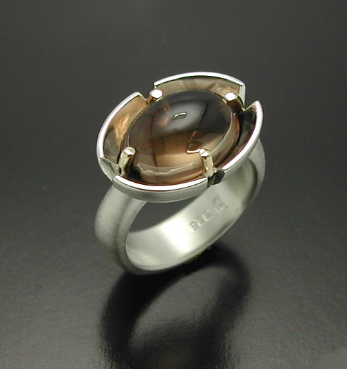 cabochon-cut-smokey-quartz-ring-in-sterling-silver-and-14kt-gold-prongs-57e9974b1.jpg