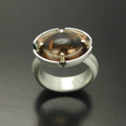 cabochon-cut-smokey-quartz-ring-in-sterling-silver-and-14kt-gold-prongs-57e9974b2.jpg