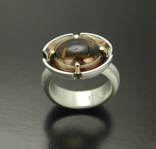 Cabochon Cut Smokey Quartz  Ring in Sterling Silver and 14kt. gold prongs.